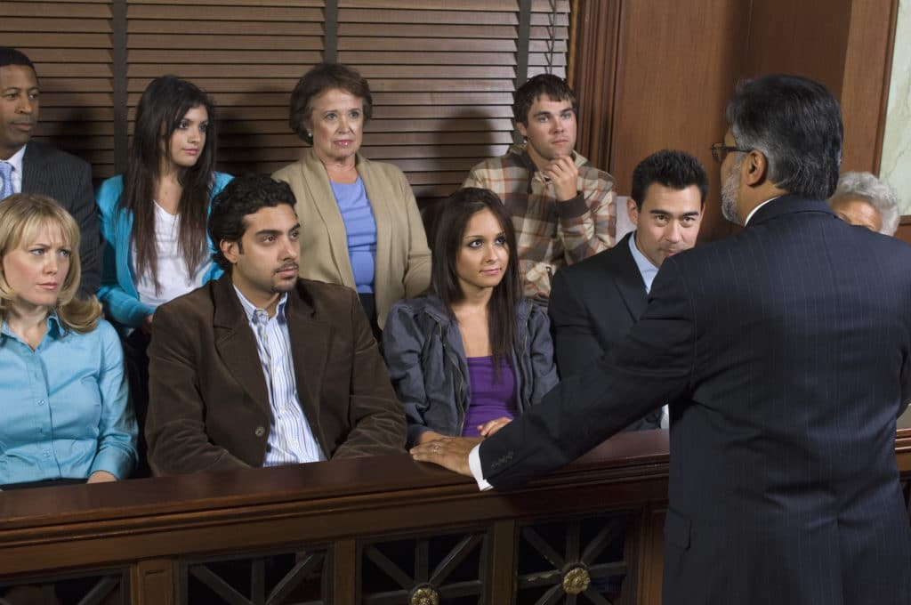 an attorney speaking to a jury of men and women